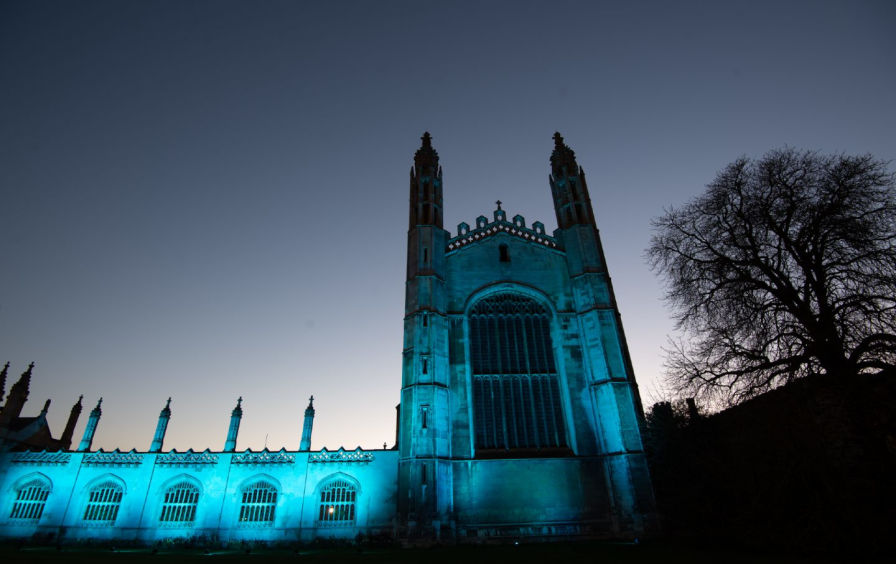 King's College at Cambridge University in the UK is bathed in blue light to celebrate NHS workers.