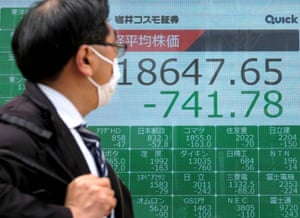 A quotation board shows falling share prices on the Tokyo Stock Exchange.