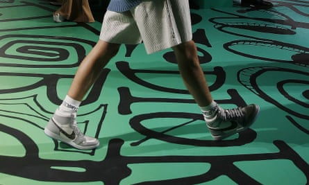 A model walks the runway wearing the Christian Dior pre-fall 2020 men's fashion collection shoe Air Dior during Miami Art Week.