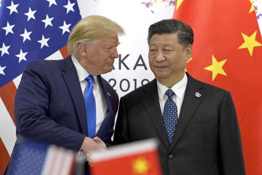 FILE - In this June 29, 2019, file photo, U.S. President Donald Trump, left, shakes hands with Chinese President Xi Jinping during a meeting on the sidelines of the G-20 summit in Osaka, western Japan. The ongoing sharp deterioration in U.S.-China ties poses risks to both countries and the rest of the world. With the U.S. presidential campaign heating up, all bets are that relations with China will only get worse. At stake are global trade, technology and security. Photo: Susan Walsh, AP / Copyright 2019 The Associated Press. All rights reserved.