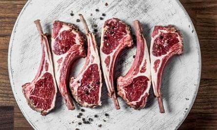 Raw fresh lamb ribs on white cutting board