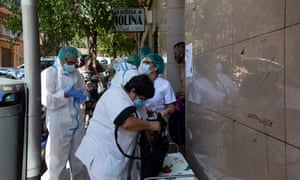 Health workers prepare to start the voluntary testing for Covid-19 that is taking place in Ripollet, Barcelona, Spain, 5 August 2020.