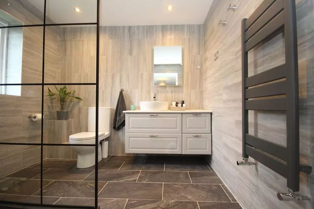 The bathroom, along with the rest of the property, is chic and modern