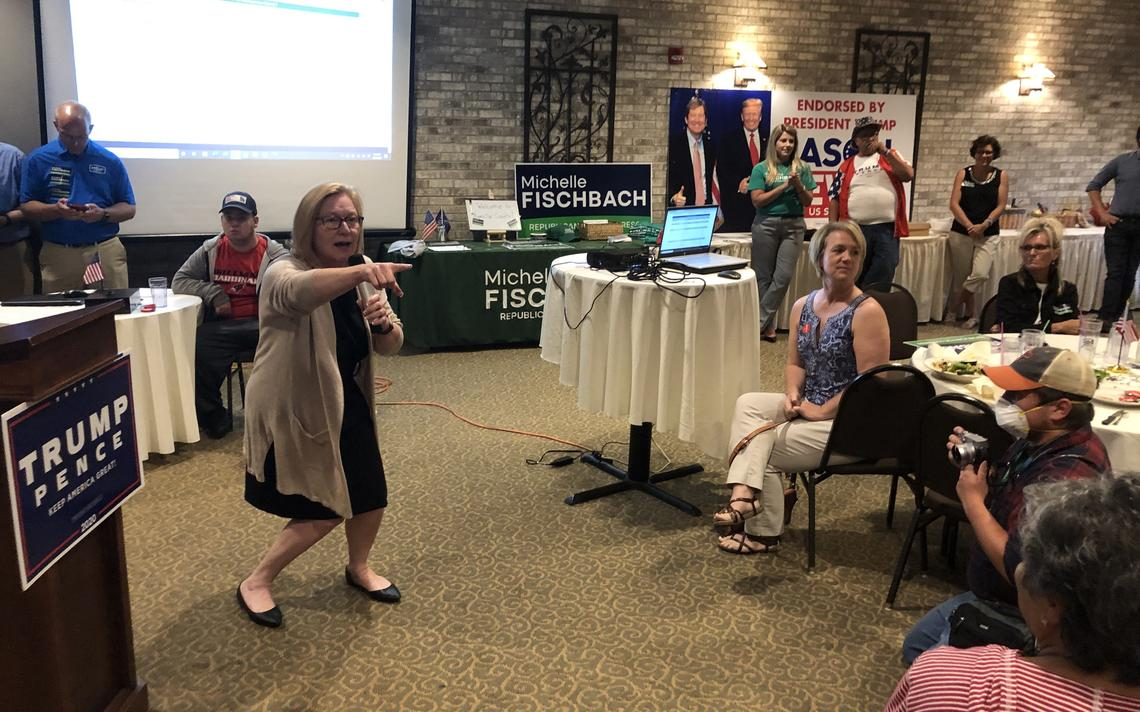 Michelle Fischbach points to waiting family members as she arrives at podium at a Republican campaign event Tuesday night in Olivia, Minnesota. Tom Cherveny / West Central Tribune