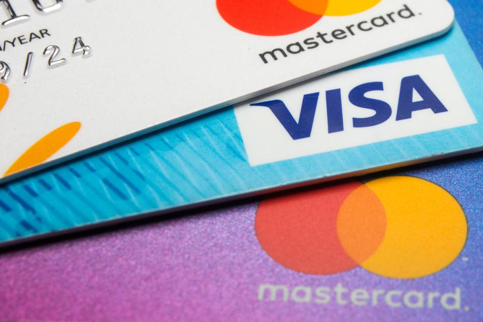 In this photo illustration a Visa credit card and Mastercard...