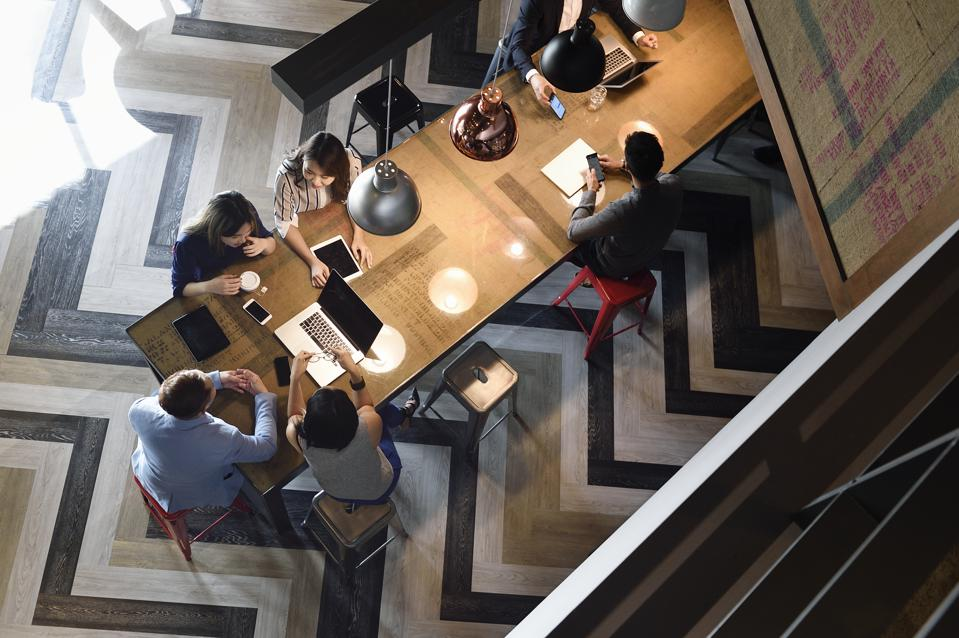High angle view of young business executives working together
