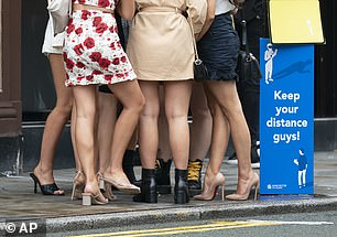 Women are seen outside a bar in Manchester on 'Super Saturday', July 4