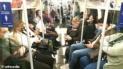Passengers commute on the busy London underground