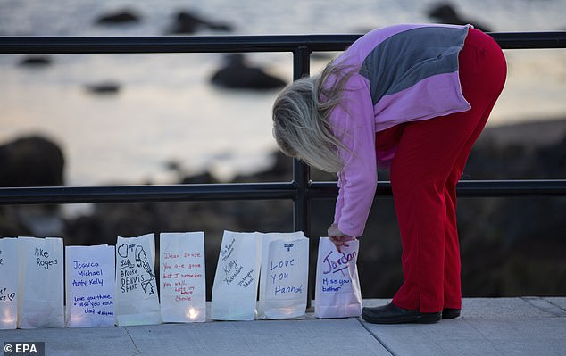 Counties in states such as California and Nevada say much of it is driven by fentanyl, the synthetic opioid 100 times stronger than morphine. Pictured: A woman tends to a luminary during a vigil in remembrance of victims of overdose deaths in Gloucester, Massachusetts, August 31