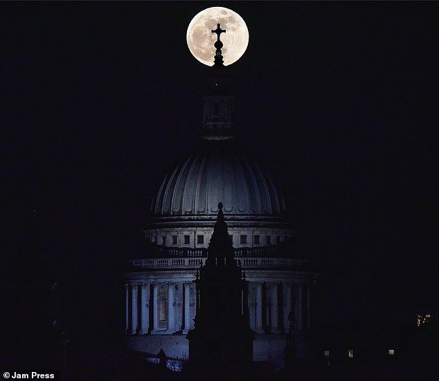 The moon is giving stargazers a treat on Halloween night with a Blue Moon that will be visible across all times zones. Our lunar neighbor will not shine blue, but the name is given because it is the second full moon to appear in the same month – the first occurs October 1. Pictured is a Blue Moon from 2018 seen in London