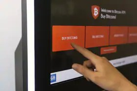 Person buying bitcoin from an ATM