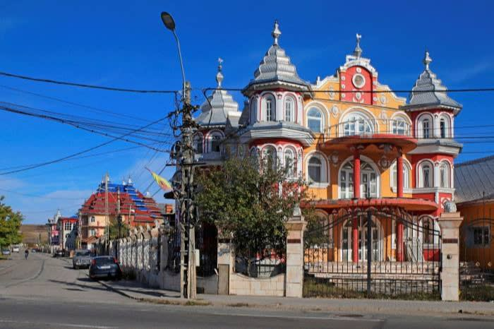 A Roma home in Romania. The buildings are a hybrid style of Balkan, Ottoman, Alpine and European traditions