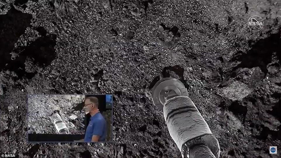 By 6.12pm the spacecraft made touchdown where its 11-foot robotic arm acted like a pogo stick and bounced on the asteroid's surface to collect dirt and dust before the craft launched back into space. A NASA simulation of the landing above