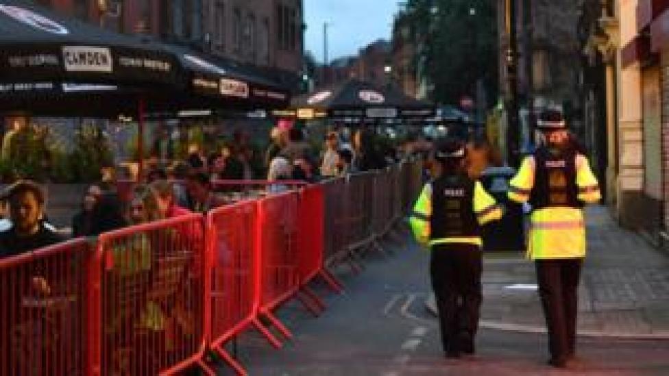 Police patrol near a bar in Manchester
