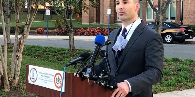 Fairfax County Commonwealth's Attorney Steve Descano announces during a news conference outside the county courthouse in Fairfax, Va., on Thursday that two U.S. Park Police officers have been indicted on manslaughter charges in the 2017 shooting death of an unarmed motorist who led officers on a stop-and-go chase after an accident. (AP Photo/Matthew Barakat)