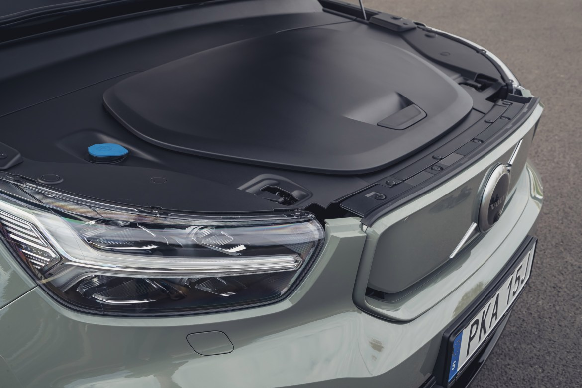 There is a front luggage compartment for storing the car's charging cable
