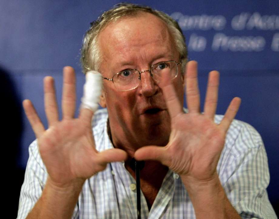 """FILE - In this Oct. 25, 2005 file photo, veteran British Middle East news journalist, Robert Fisk, gestures during a press conference for the launch of the French version of his book """"The Great War for Civilisation: the Conquest of the Middle East,"""" in Paris, France. Fisk, one of the best-known Middle East correspondents who spent his entire career reporting from the troubled region and won accolades for challenging mainstream narratives died Sunday at a hospital in Dublin after a short illness. He was 74. Photo: FRANCOIS MORI, AP / AP2005"""