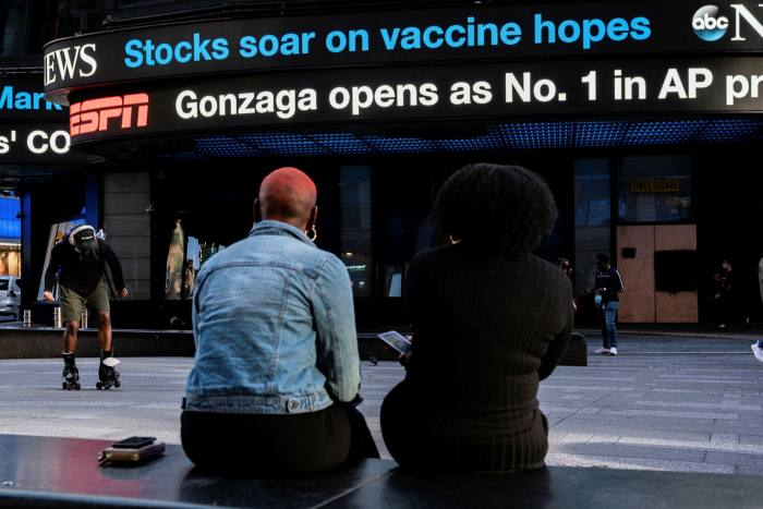 A billboard in Times Square delivers stock market updates after a vaccine announcement on November 9 2020