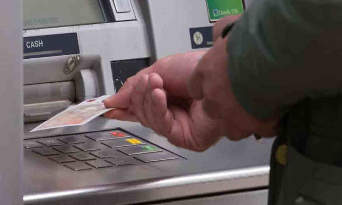 Someone withdraws money from an ATM