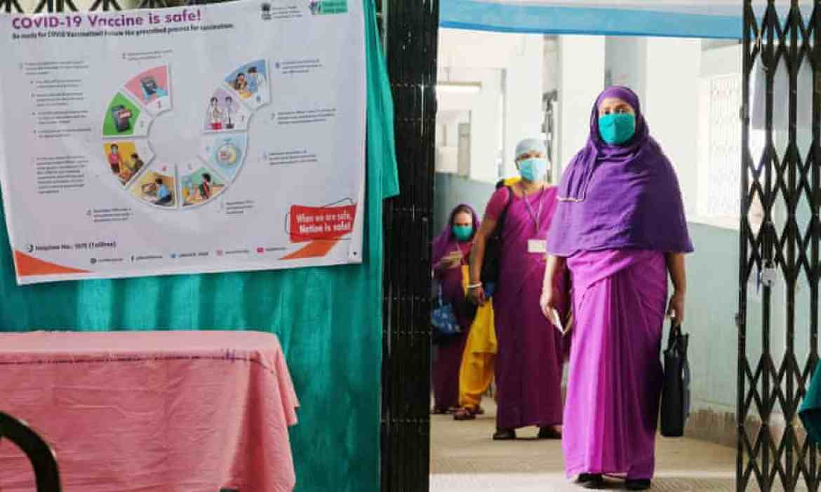 Health workers wait to get vaccinated at Madhyamgram hospital in Kolkata