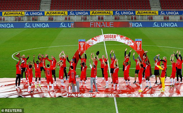 FC Red Bull Salzburg players celebrate winning the Austrian Cup on May 20, 2020.Play resumed behind closed doors following the outbreak of the coronavirus disease