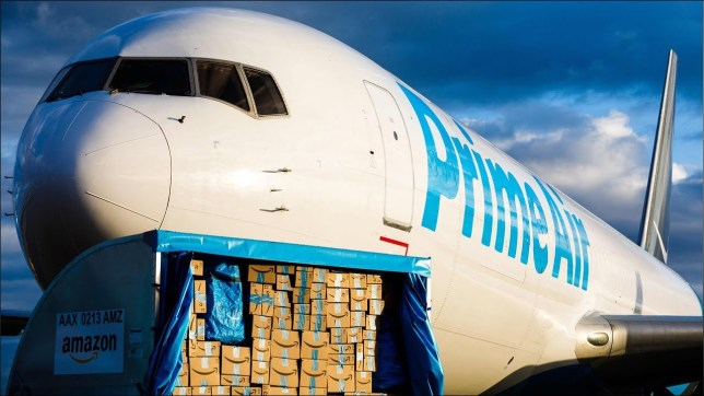A jet branded with Amazon's Prime Air logo being loaded with cargo (Getty)