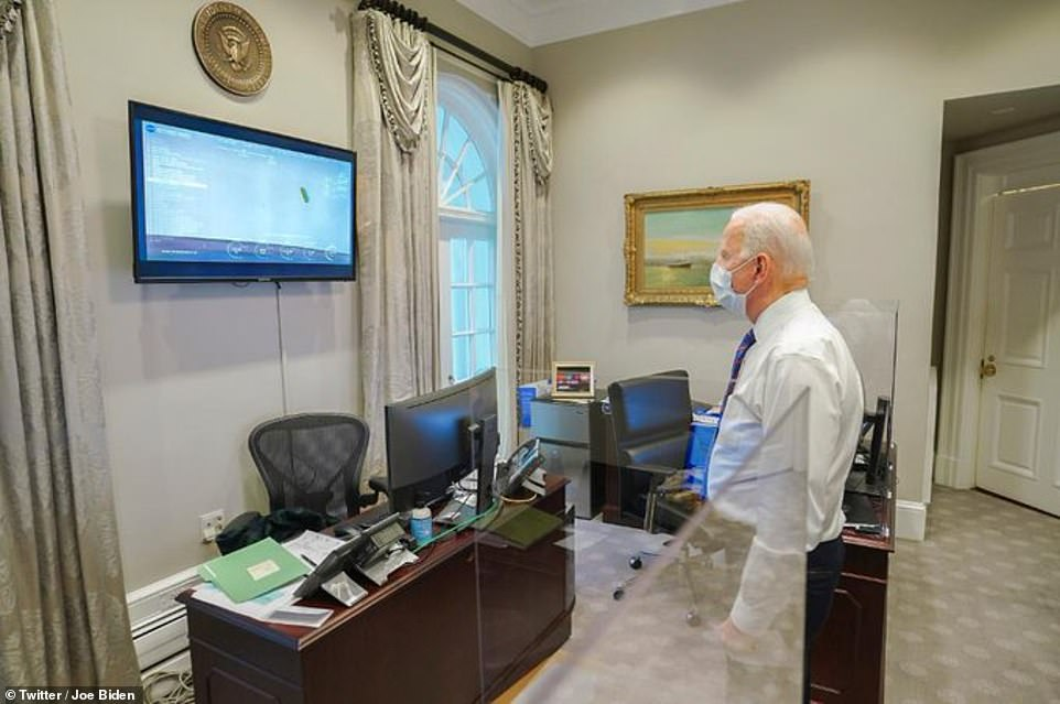 Pictured, US President Joe Biden watching the NASA Perseverance landing live in his office. The landmark landing occurred shortly before 4pm ET (9pm GMT) last night and was watched live by millions
