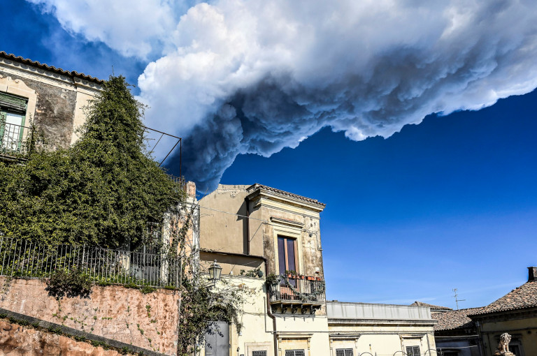 Dense smoke caused by Etna's eruption on the houses of Trecastagni in Catania, Italy. (Getty Images)