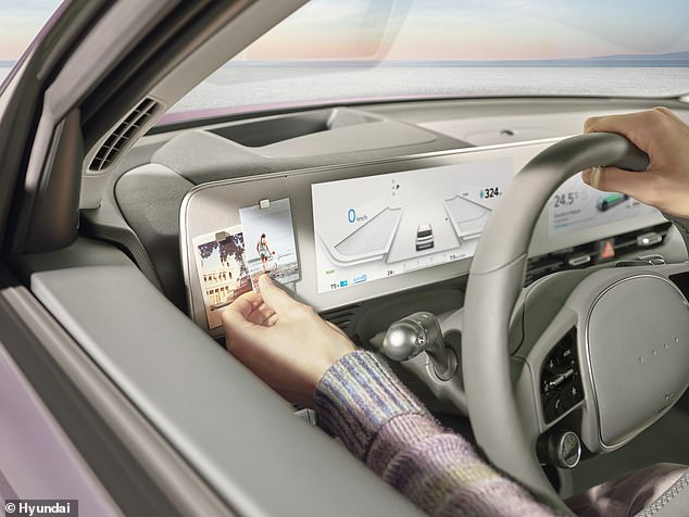 The dashboard even has a small area for the driver to pin photos of their loved ones