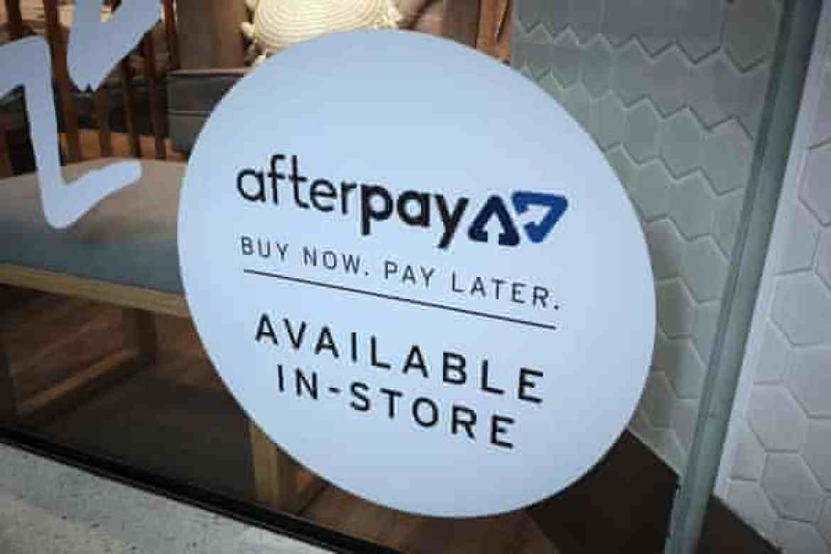 An Afterpay sign is seen in a store window in a shopping centre in Sydney. Over the past year, the share price of Afterpay has more than tripled.