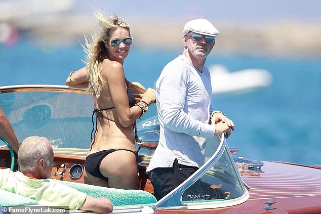 Model Elle Macpherson went on holiday to Ibiza with bank executive Roger ¿Big Dog¿ Jenkins, a man once paid £65 million for two years¿ work, and her sons Aurelius and Arpad