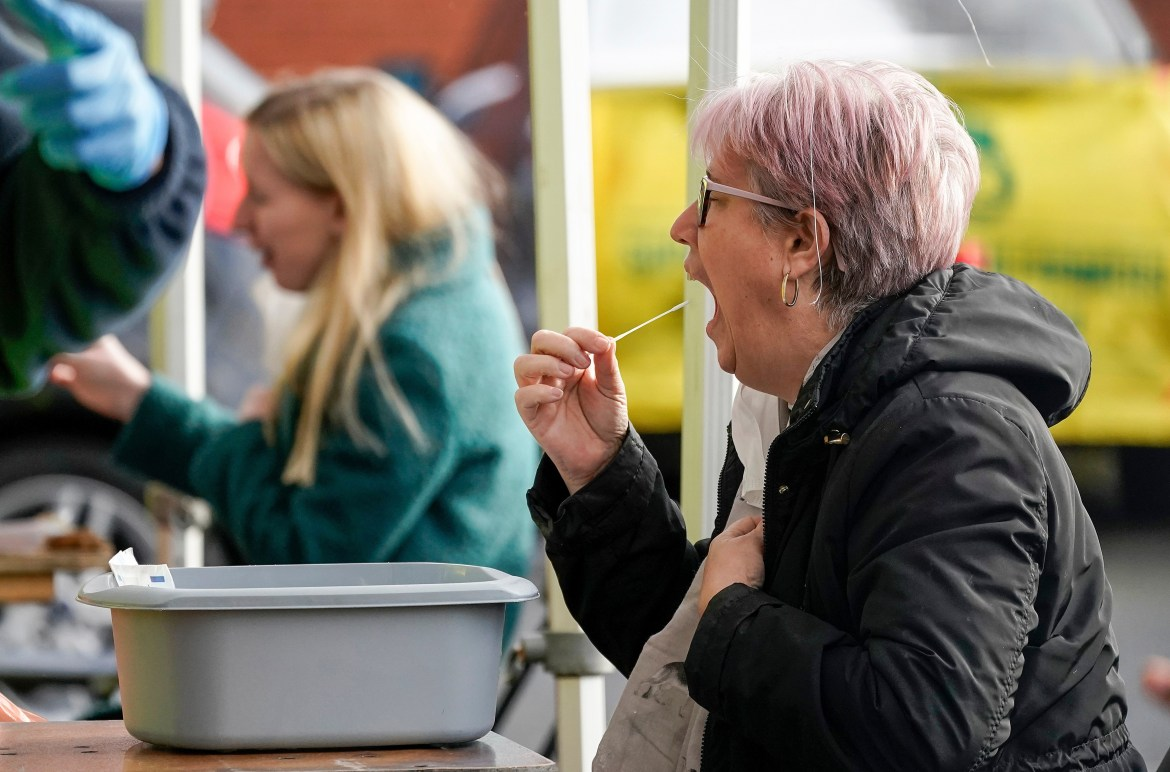 A testing site in Manchester as a woman takes a swab test