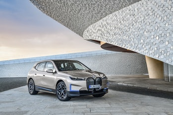 An image of an SUV with a futuristic building
