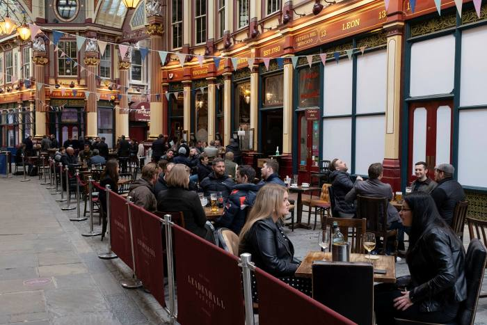 People drinking outside the Lamb Tavern in Leadenhall Market