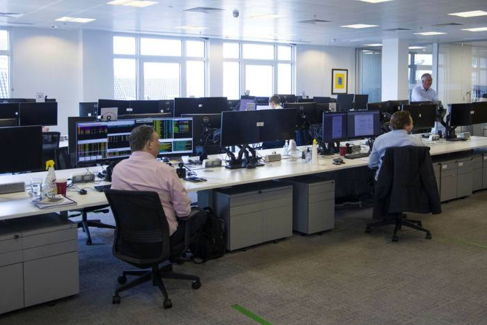 Staff at N+1 Singer in the City of London at their desks