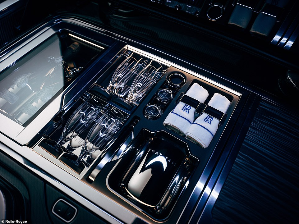 The section also provides space for four glasses, napkins and other accoutrements - as you can see in this amazing image