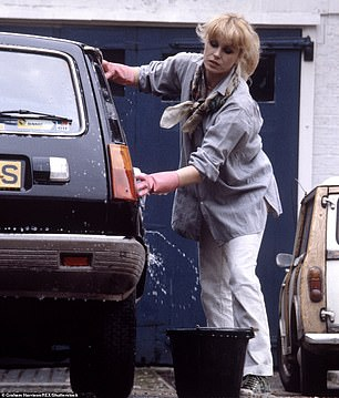 Style icon... and then there's the car:Joanna Lumley, photographed washing her Renault 5 outside her flat in London's Holland Park