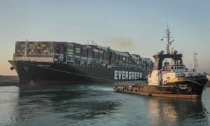 The Ever Given cargo ship being is pulled through the Suez Canal after being freed late last month.