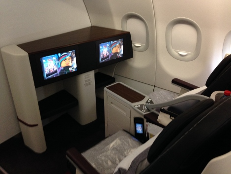 Row 1, A319 all-business class Qatar Airways