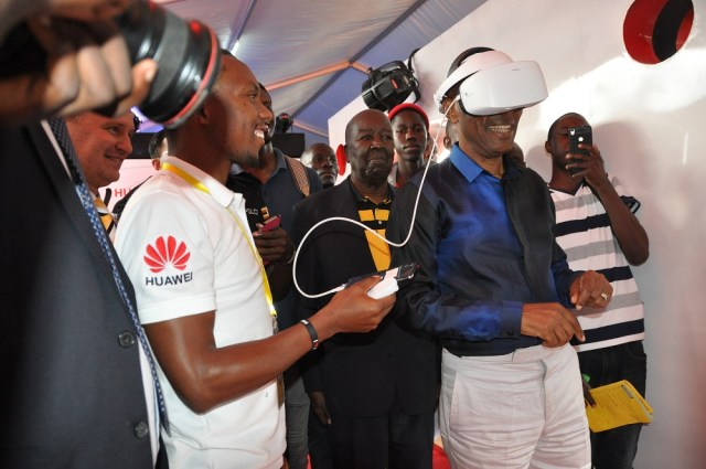 UCC Executive Director Godfrey Mutabaazi enjoying the VR 2 Technology at the Huawei Booth at MTN@20 Expo and anniversary.