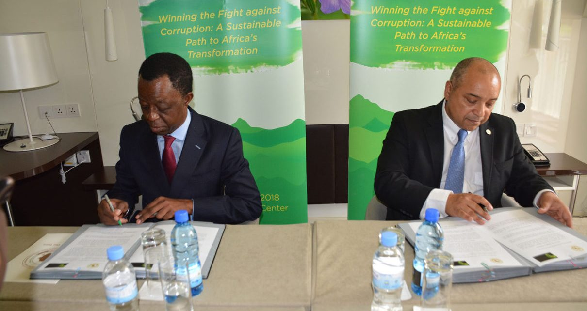 African Tax Administration Forum Executive Secretary Logan WORT and the President of the Pan-African Parliament Roger Nkodo DANG sign documents to strengthen tax laws in Africa
