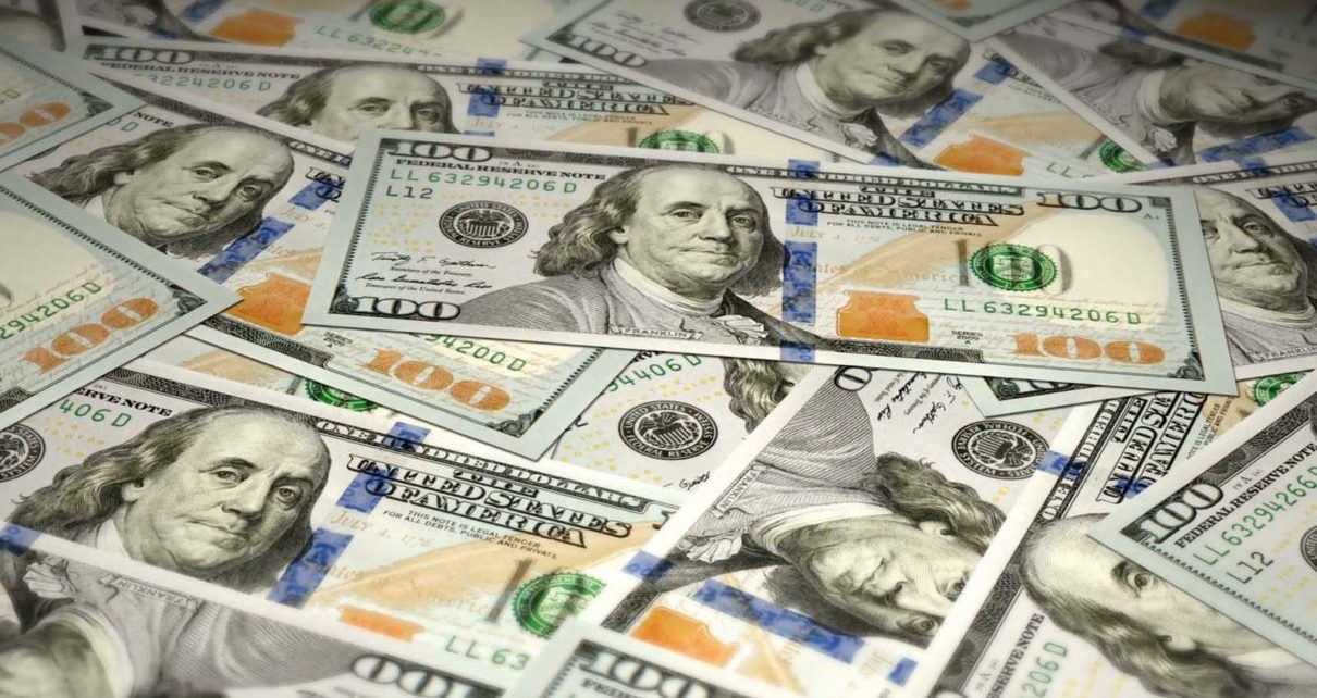 The U.S. dollar eased on Tuesday, but still remained near a 16-month high in anticipation of Federal Reserve rate hikes.