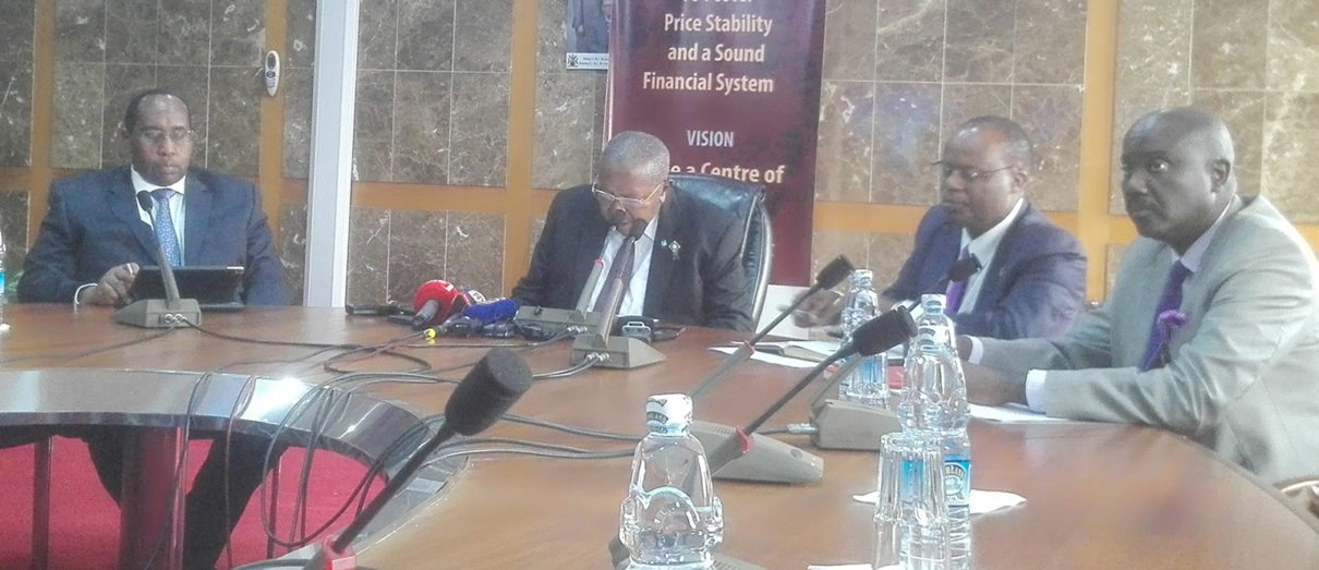 Bank of Uganda officials led by Governor Emmanuel Tumusiime Mutebile (2nd left) present the CBR in Kampala today