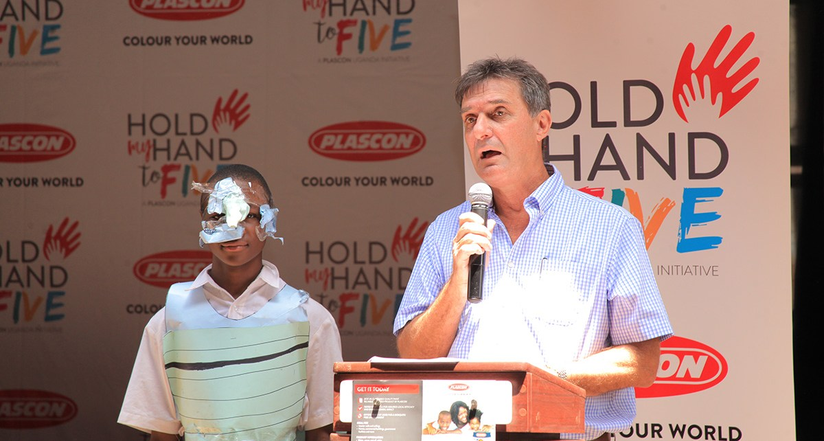 Mr Chris Nugent, the Kansai Plascon Managing Director speaks during the launch of the Hold my Hand to 5 campaign, healso handed over the newly refurbished class room blocks to Nakasero Primary School