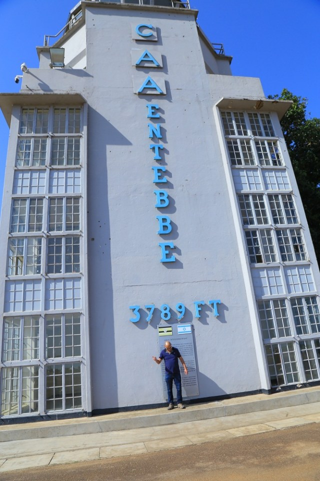 One of the tourists taking photos at the Entebbe Airport Old Tower building where Israelis were held hostage by the Late Idi Amin Dada.