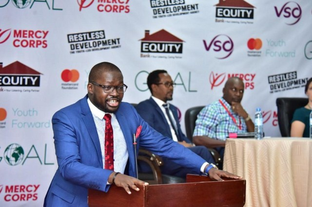 Equity Bank's Head of Marketing and Communications Phillip Otim speaking at the partnership launch