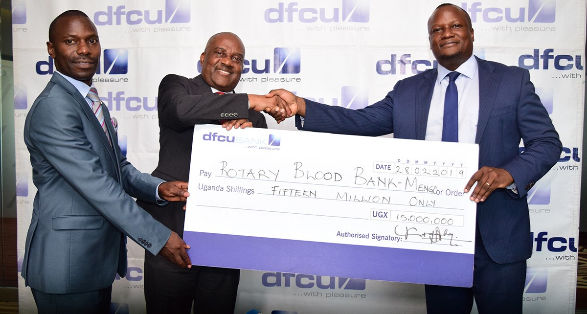 dfcu CEO Mathias Katamba hands over cheque for Rotary Blood Bank Mengo