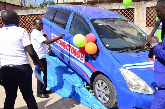 Paddy Muramiirah (R), CEO Crown Beverages (Pepsi) after test-running  one of the cars while Mr. Isaac Sekasi (L) and other Crown Beverages looks on during the media launch of the Tukonectinge with Pepsi Campaign that took place today, 11th April 2018 at the company's Headquarters in Nakawa industrial area.