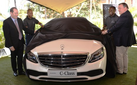 Ian Middleton (left), the Managing Director of DT Dobie Edward Githinji (Second left), Sales Executive, Gerald Trempont (right), CFAO Brand Manager and Lawrence Kiambati (second right), Senior Sales Executive unveil the new Mercedes Benz C Class luxury saloon for the Kenya market.