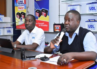 Moses Zizinga, the Uganda Batteries Limited Marketing Director (L) with Marvin Mulinde the Head of Legal Services at Uganda Batteries Limited addressing a press conference at their head offices.